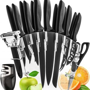 17 piece knife set with black handles in an acrylic stand. Knife sharpener is on the left side with sliced apple and orange in picture