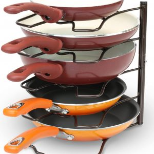 bronze cabinet pan organizer with three red skillets on top with two orange skillets on bottom of horizontal slats