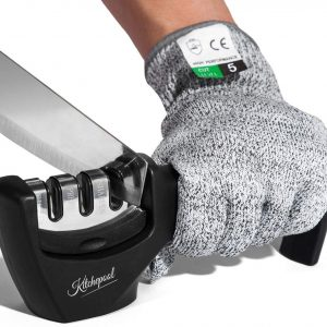 black and stainless steel knife sharpener with a person wearing grey glove sharpening knife
