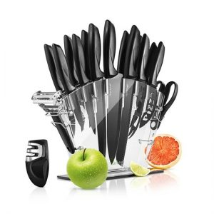 17 piece knife set with black handle in an acrylic knife stand with an apple and orange on either side